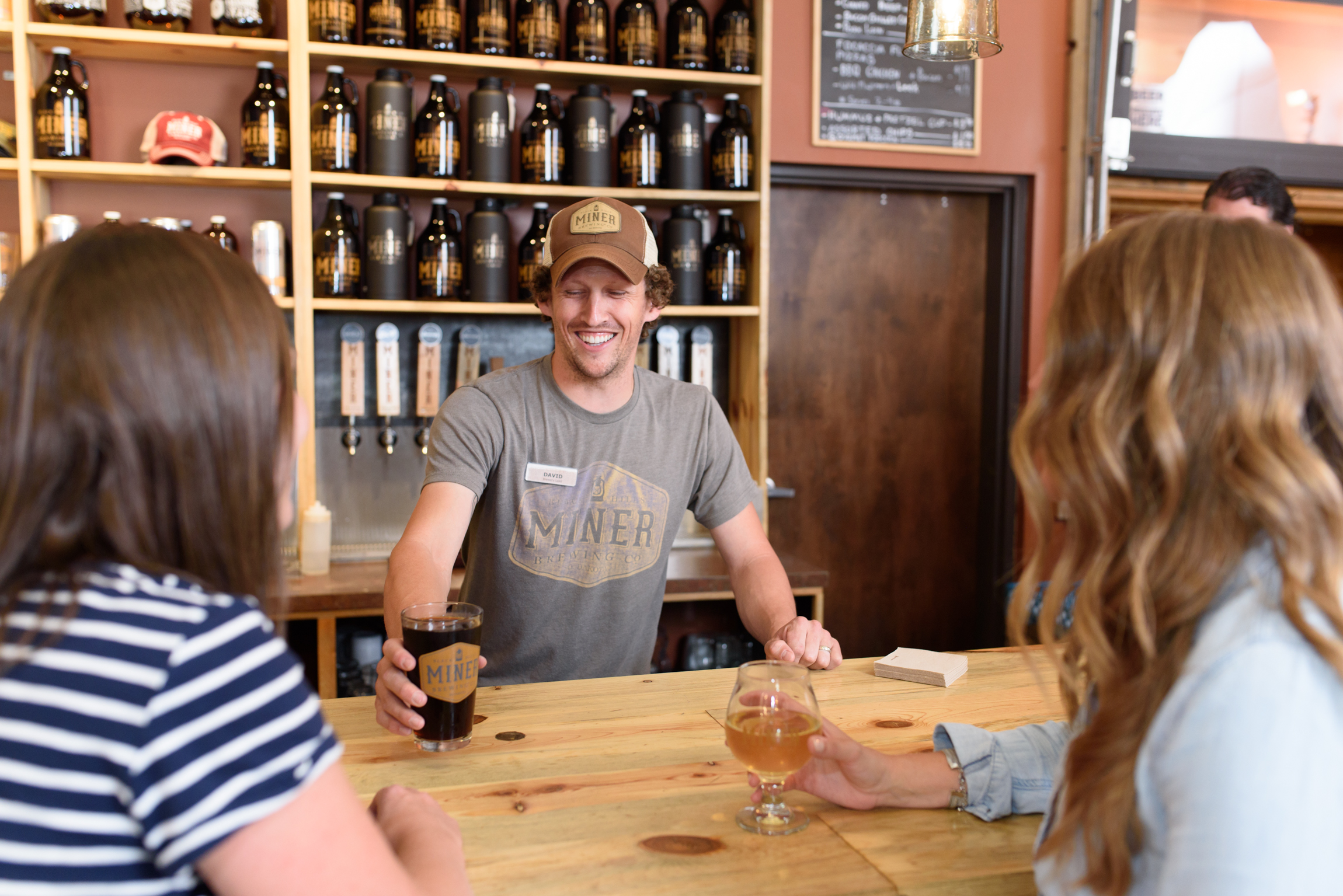 Guests enjoy a pint of beer at Miner Brewing Company near Hill City, South Dakota.