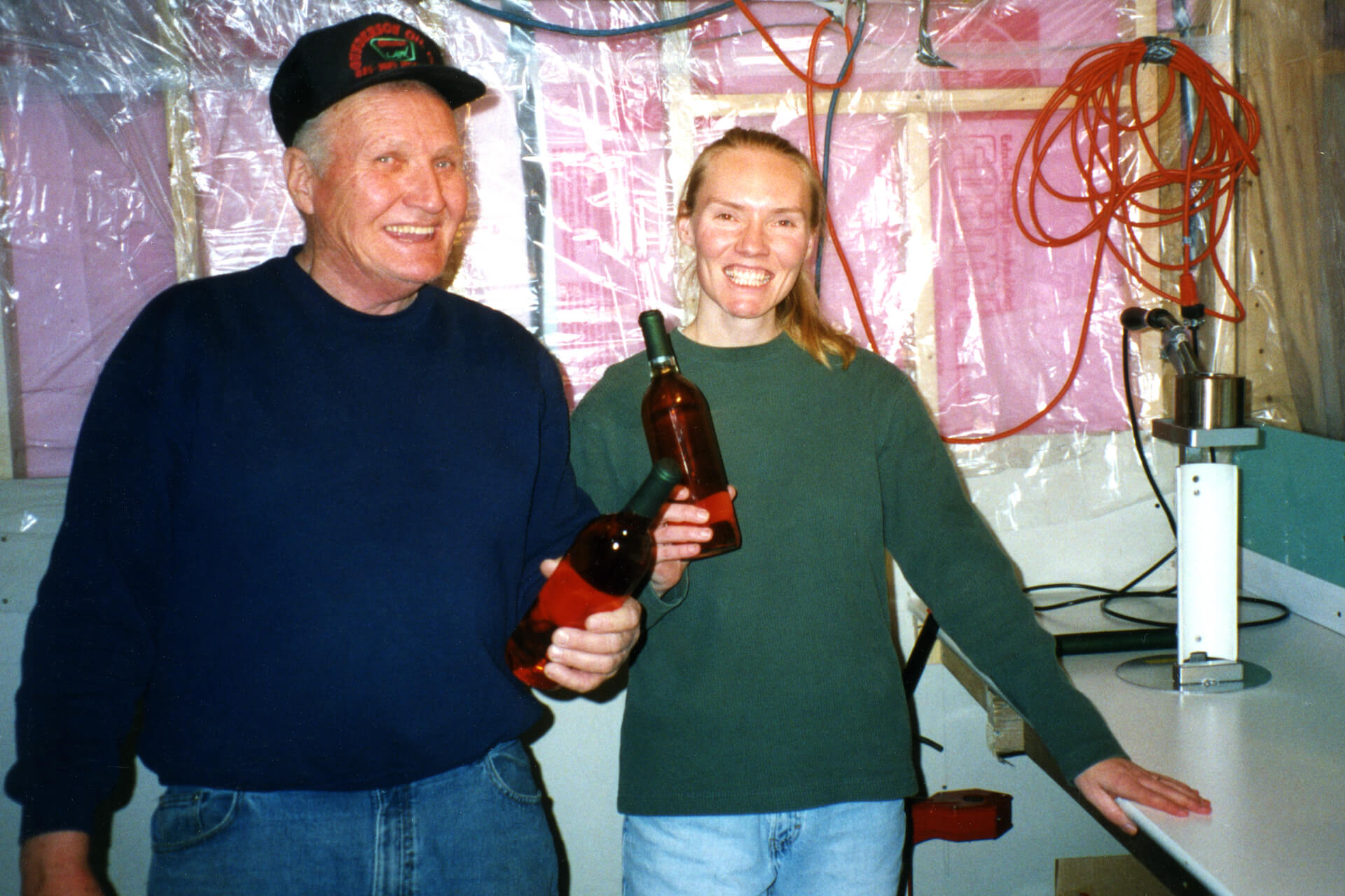 Ralph and Sandi pose in Mobridge, South Dakota, with bottles of Razzy Apple, Prairie Berry Winery's first commercial release