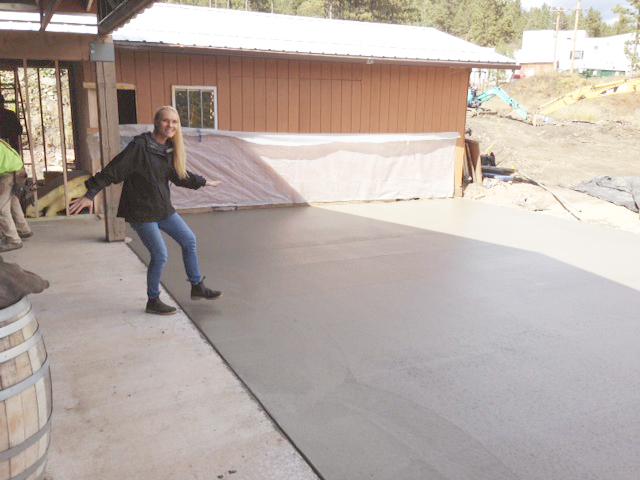 Brewmaster Sandi Vojta jokes around near the newly poured concrete patio at Miner Brewing Company