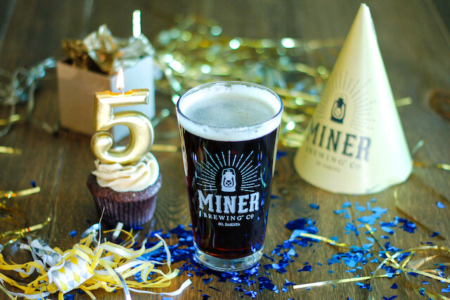 Birthday supplies around a Miner Brewing Company beer to mark 5 years in business